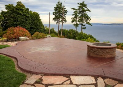 Decorative stamped concrete patio and fire pit in Hansville, WA
