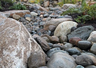 River rock bed in landscape in Bremerton, WA
